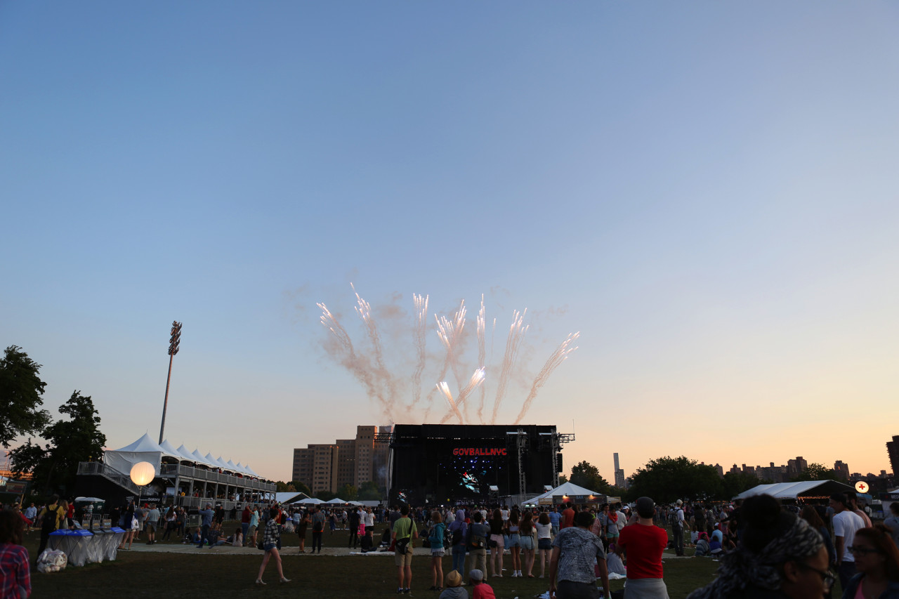 Fireworks from afar during Bjork's set at the GovBallNYC stage at Governors Ball on Randall's Island, New York, on June 6, 2015. (© Michael Katzif – Do not use or republish without prior consent.)